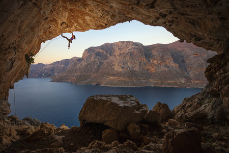 lead rope: Female rock climber on a cliff in a cave at Kalymnos, Greece