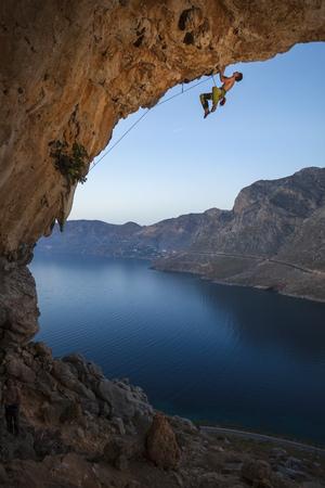 extreme sports: Rock climber at sunset, Kalymnos Island, Greece