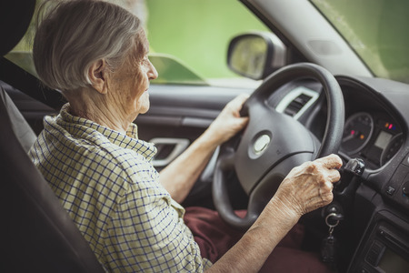 old keys: Senior woman driving a car Stock Photo
