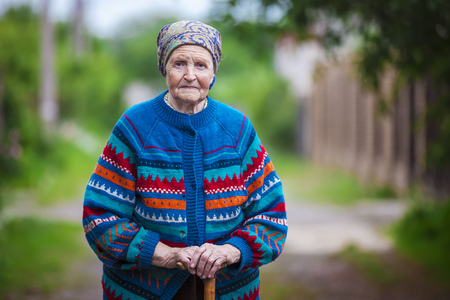 headscarf: Portrait of an aged woman outdoors