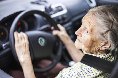 Senior woman driving a car Standard-Bild