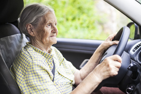 new ages: Senior woman driving a car Stock Photo