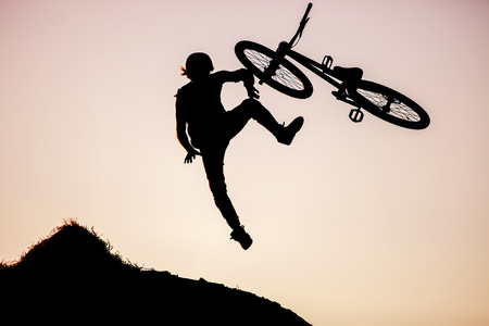bmx bike: Extreme rider making a bike jump Stock Photo