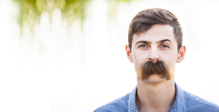 mustache: Young man with fake mustaches. Dental health concept. Stock Photo
