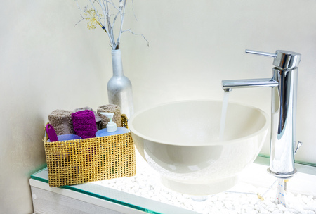 Closeup of wash basin in modern bathroom interior Standard-Bild