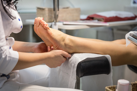 spa pedicure: Cropped view of woman getting a pedicure and foot massage Stock Photo