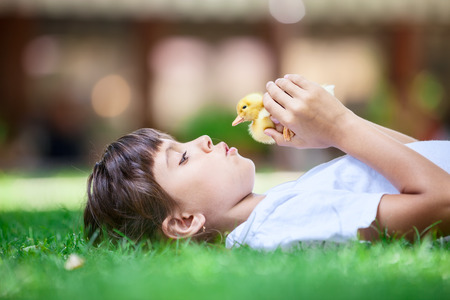girl lying: Cute girl with a spring duckling