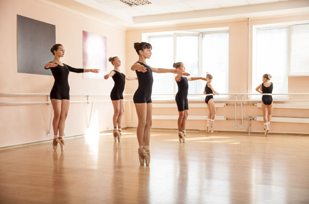 only adult: Dancer is doing exercises in ballet class Stock Photo