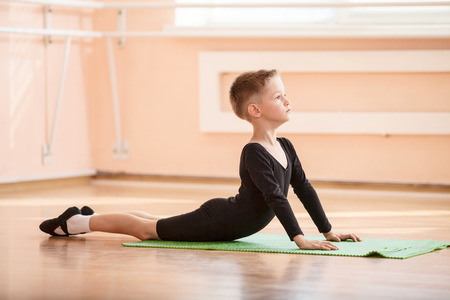 Boy dancer doing exercise at ballet dance class