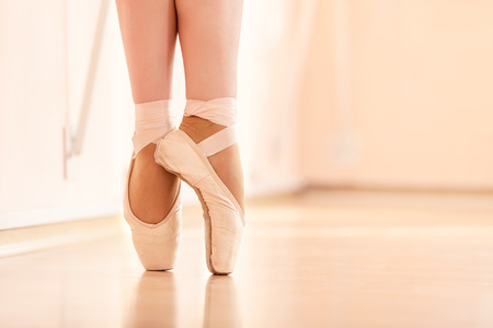 Legs of young ballerinas, ballet dancing class Stock Photo