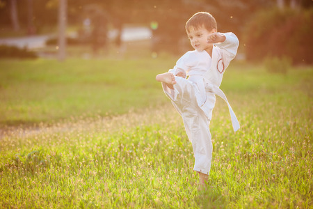 arts: Preschool boy practicing karate outdoors Stock Photo