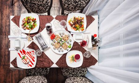 restaurant dining: Table at restraurant served for four people