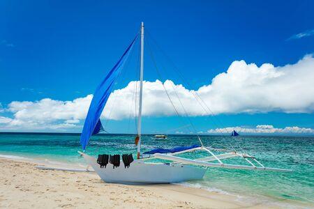 boracay: Boat docked on sand beach, Boracay island, Philippines