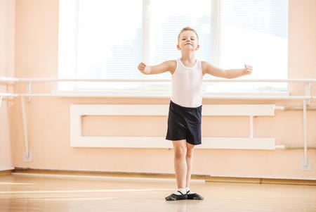 Young boy dancing at a ballet class
