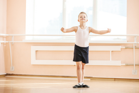 Young boy dancing at a ballet class
