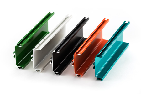 Samples of colorful aluminum profiles over white background Banque d'images