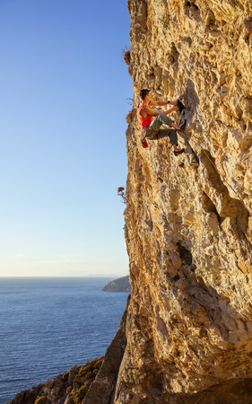 Male rock climber on a face of a cliff Stock Photo