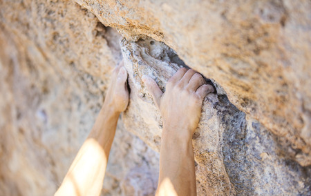 crack climbing: Close up of climbers hands on a cliff