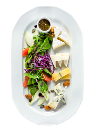 ensalada de frutas: Selection of different kinds of cheese with greens and fruit. view from above. Foto de archivo