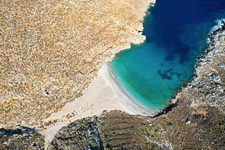 Birds eye view of bay with beautiful beach near Sikati cave, Kalymnos island, Greece