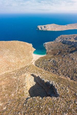 Birds eye view of Sikati cave and coast nearby, Kalymnos island, Greece. Panoramic pidture of landmark on summer day. Stock Photo