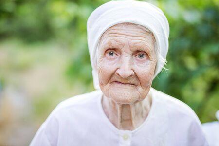 Closeup portrait of senior woman outdoors 版權商用圖片