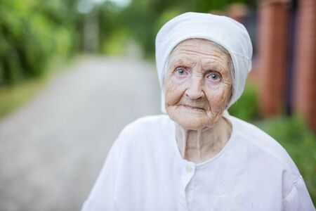 Portrait of senior woman outdoors in countryside