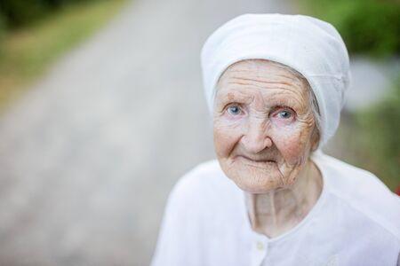 Portrait of smiling senior woman outdoors l
