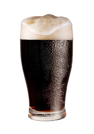 pint of dark beer isolated on white background 免版税图像