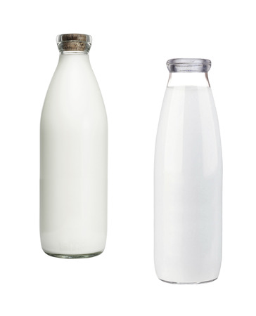 Two milk bottles isolated on white background Stock Photo