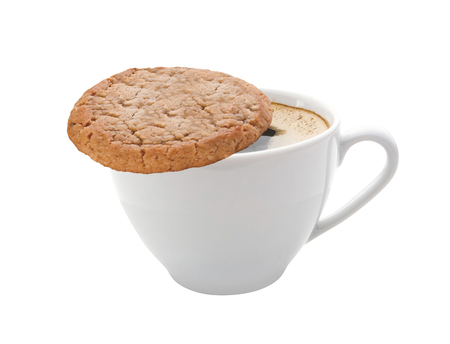 Cup of coffee and a cookie isolated on white background