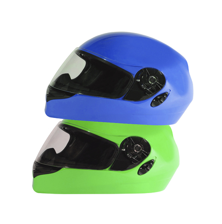 Blue and green bike helmets isolated on white background