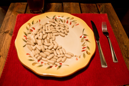 Pills on a dinner plate. To much medicine