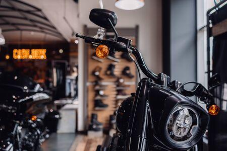 Motorbike front light. Metal made headlight of motorcycle. Part of chromium driving steering of bike.