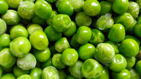Detail of pea balls with a bit of ice on it. It seem the pea was just put out of the freezer. It's green, delicious, and ready to eat or made as ingredient for cooking.