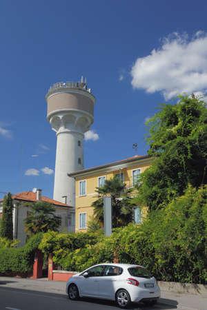 Via Sebastiano Coletti Street and tower. Margera, Mestre, Venice, Italy