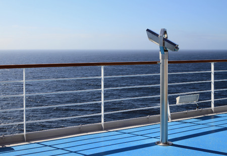 cruise liner: Telescope on walking deck of cruise liner