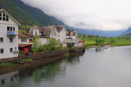 olden: Houses on river Oldeelva. Olden, Norway Editorial