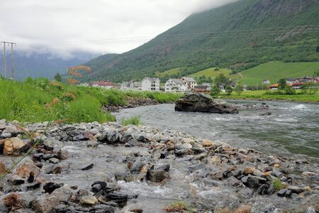 olden: On Oldeelva river banks. Olden, Norway Stock Photo