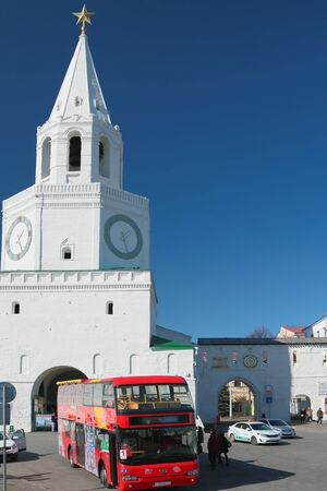 spasskaya: Spasskaya Tower of Kazan Kremlin and red tourist bus. Tatarstan, Russia