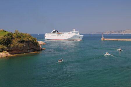 the entering: Passenger-and-freight ferry entering port water area. Marseille, France Stock Photo