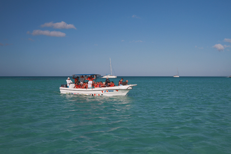 excursion: Boat with tourists during excursion to shoal. Palmilla, Dominican republic Stock Photo