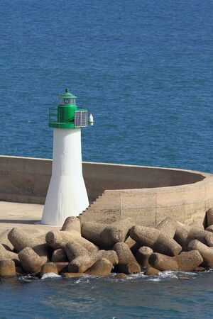 beacon: Beacon, pier, sea. Cagliari, Sardinia