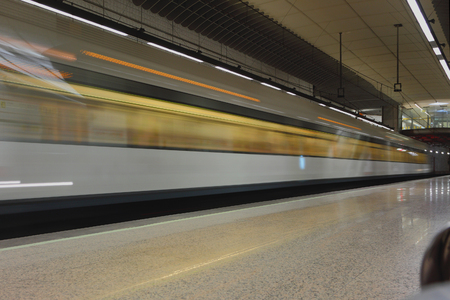 Subway train in movement at station. Valencia, Spain