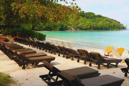 lounges: Chaise lounges on beach. Port Launay, Mahe, Seychelles Stock Photo