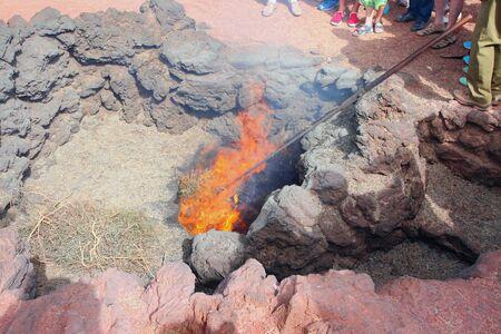 timanfaya: Burning of straw from volcanic heat. Timanfaya, Lanzarote, Spain