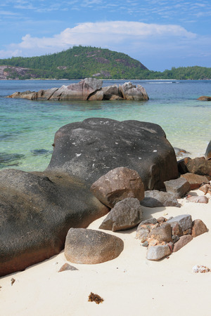 Boulders and stones on coast of gulf Anse Islette. Port Glod, Mahe, Seychelles