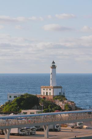 Beacon in seaport. Ibiza, Spain