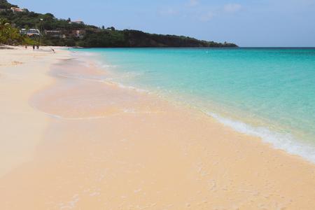 Sandy beach, sea and cape. St. George's, Grenada Stock Photo