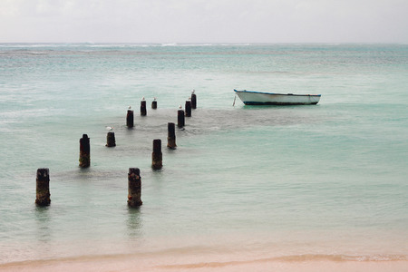 Support of pier, boat and ocean. Anse de Sent An, Pointe-a-Pitre, Guadeloupe